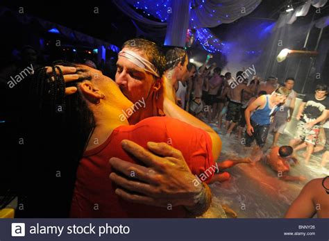 Couple kissing passionately on the dancefloor during a