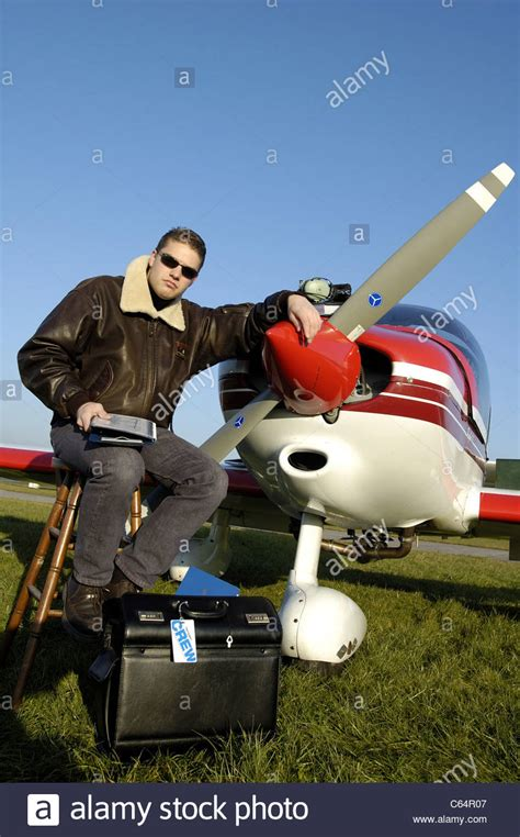 Private pilot posing front of propeller of small plane