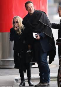 Mary-Kate Olsen and a content-looking Olivier Sarkozy look