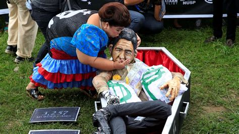 Is it time to bury Marcos' past in the Philippines
