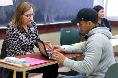 Academic counselors answer one-on-one student questions at